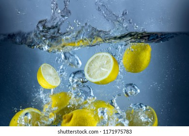 Lemons fresh splash in water yellow fruit food tropical