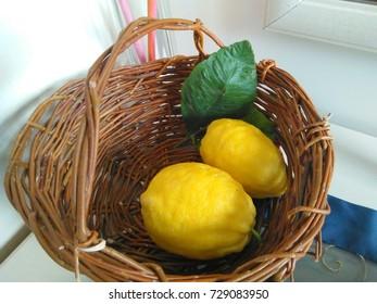 Lemons in a handmade basket.