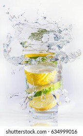 Lemons and limes in the glass. Concept and idea of drink