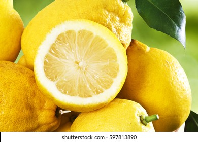 lemons on grass with green background