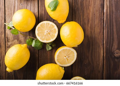 Lemons  on a wooden background.