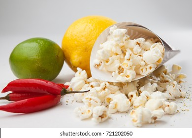 Lemons peppers and popcorn on while table