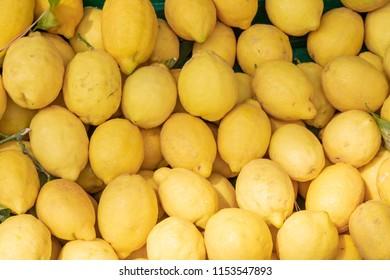 Lemons pile on a market stall