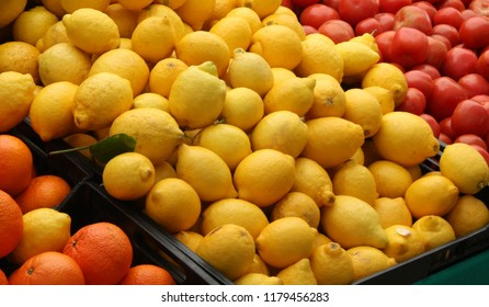 Lemons, tomatoes and oranges on a market stand in Spain.