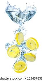 Lemons and water splash. Tasty and healthy food