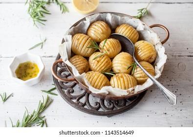 Lemony rosemary potatoes on white table