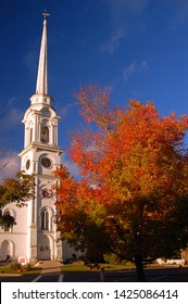 L:emox, MA, USA October 11, 2007 Autumn Colors compliment a traditional New England church in Lenox, Massachusetts