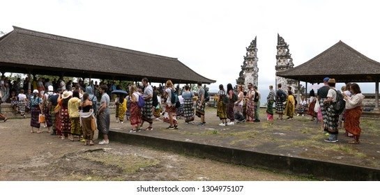 Lempuyang, Bali / Indonesia - August 16th 2018: Overcrowded balinese Lempuyang temple gates. Tourists are waiting in line for 2 hours to take a photo.