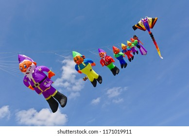 Lemwerder, Germany - August 18th, 2018 - A row of kites strung together depicting Snow White and the seven dwarfs at the Lemwerder Kite Festival