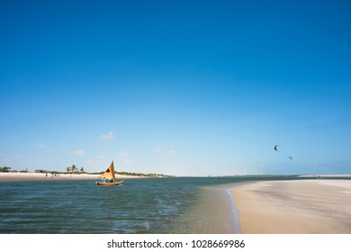 Lencois Maranhenses National Park, Brazil - July 15, 2016: A traditional fishing boat sails along the ocean channel to the tide in Atins
