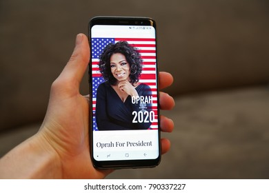 LENDELEDE, BELGIUM - JANUARI 9TH 2017: a hand holding a new Samsung Galaxy S8 mobile phone with Oprah For President 2020, by TheBlackMedia on the screen. Illustrative editorial on interior background.