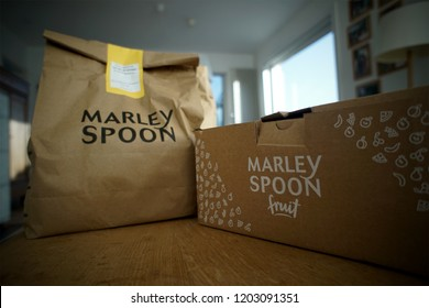 LENDELEDE, BELGIUM - JULY 18TH 2018: a detail of a Marley Spoon paper bag and a box standing on a table after being delivered. Marley Spoon is a food delivery company. Illustrative editorial image.