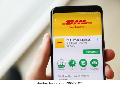 LENDELEDE,BELGIUM-JANUARY 28 2019: A hand holding a Samsung Galaxy S9 with the DHL parcel delivery app on the touch screen. DHL is the world's largest logistics company. Illustrative editorial