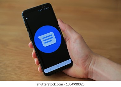 LENDELEDE,BELGIUM-MARCH 28TH 2019: a hand holding a Samsung Galaxy S9 mobile phone that displays the logo of Google Messages, also known as Android Messages on the touch screen. Illustrative editorial
