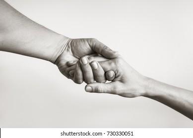 Eine helfende Hand zu leihen. Solidarität, Mitgefühl und Wohltätigkeit.