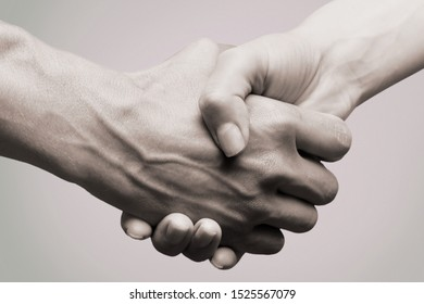 Lending a helping woman and man hand concept