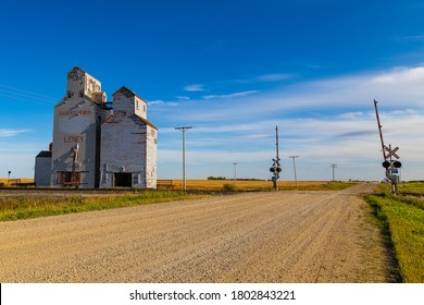 Leney, Saskatchewan / Canada - 08 23 2020: An old grain elevator that used to be a significant part of prairie farming culture are being torn down, vandalized and left in a state of disrepair
