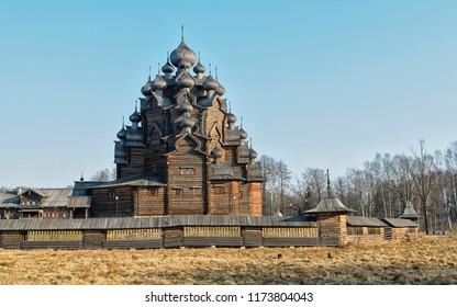 Leningrad district (Saint Petersburg suburbs), Russia. Wooden Pokrovskaya church at the Bogoslovka manor. Spring morning view.