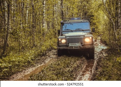 Leningrad Oblast, the Karelian isthmus, Russia, may 30, 2014. Land Rover Defender in the forests of the Karelian isthmus, Land Rover Defender is a classic English frame SUV