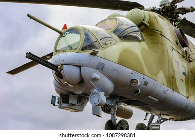 LENINGRAD REGION, RUSSIA - Apr. 22, 2018: Low angle view to gun, cockpits and part of the fuselage of a Mil Mi-24 (NATO reporting name: Hind) military attack helicopter.