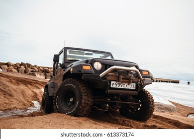Leningrad region, Russia - April 01, 2017. Jeep Wrangler on the beach of the Gulf of Finland in the Leningrad region. Wrangler is a compact SUV produced by Chrysler