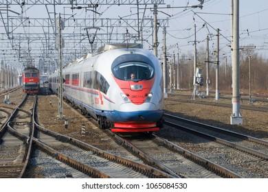 "LENINGRAD REGION, RUSSIA - APRIL 09, 2018: Modern high-speed train EVS1-16 ""Sapsan"" in motion"
