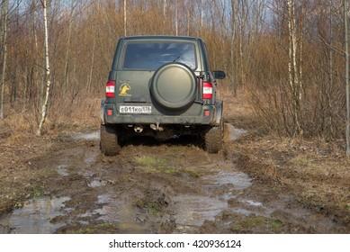 LENINGRAD REGION , RUSSIA - APRIL 16, 2016: UAZ Patriot off-road in the spring forest