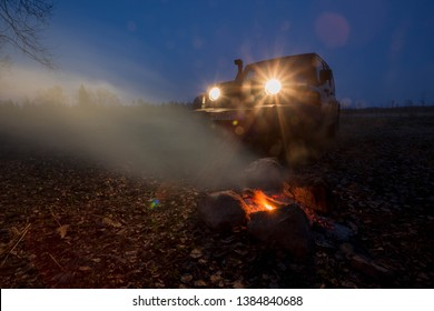 Leningrad region, Russia, April 24, 2019: jeep Wrangler at campfire. Wrangler is a compact four wheel drive off road and sport utility vehicle
