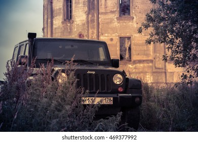 Leningrad region, Russia , August 14, 2016 , Jeep Wrangler abandoned water tower Inca in the Leningrad region, the Jeep Wrangler is a compact four wheel drive off road and sport utility vehicle