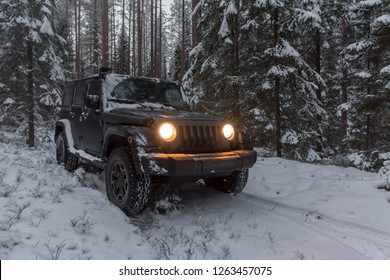 Leningrad region. Russia, December 20, 2018: Jeep Wrangler in a snowy forest. Leningrad region . Wrangler is a compact four wheel drive off road and sport utility vehicle