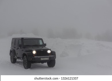 Leningrad region, Russia, February 23, 2019: Jeep Wrangler on a snowy forest road in the Leningrad region. Wrangler is a compact four wheel drive off road and sport utility vehicle