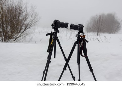 Leningrad region, Russia, February 23, 2019: test Canon SLR camera and Nikon SLR camera. Veps forest. Russia