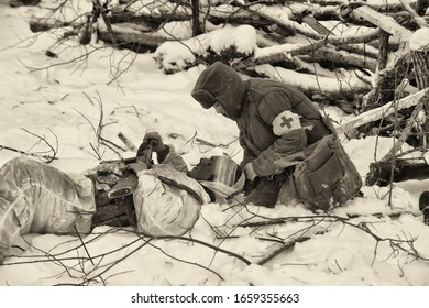LENINGRAD REGION, RUSSIA - January 22, 2012: Soviet soldiers of World War II. Military-historical reconstruction of the battle, which lifted the siege of Leningrad