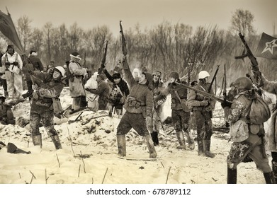 LENINGRAD REGION, RUSSIA - JANUARY 22, 2012: The german gunners during the Second world war to occupy the position. Military-historical reconstruction of the battle that broke the siege of Leningrad