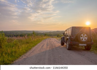 Leningrad region, Russia, July 27, 2018: Jeep Wrangler on a rural road in the evening sun. Wrangler is a compact four wheel drive off road and sport utility vehicle