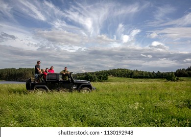 Leningrad region. Russia. June 25, 2018: A Jeep Wrangler convertible with people, on a forest road in the Leningrad region