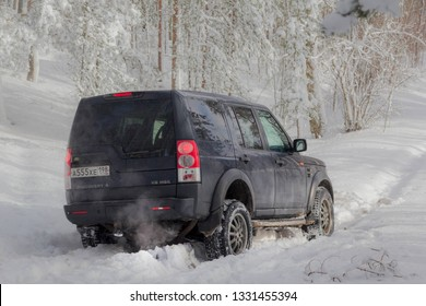 Leningrad region, Russia, March 4, 2019: land Rover Discovery on a snowy forest road in the Leningrad region. Discovery is a compact four wheel drive off road and sport utility vehicle