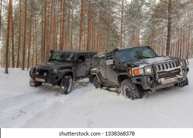 Leningrad region, Russia, March 4, 2019: Hummer H3 and Jeep Wrangler Jk on a snowy forest road in the Leningrad region. H3 and jk  is a compact four wheel drive off road and sport utility vehicle