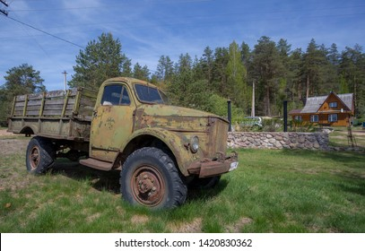 Leningrad region, Russia, may 15, 2019: jeep Wrangler and an old German Studebaker truck in a Russian village. Wrangler is a compact four wheel drive off road and sport utility vehicle