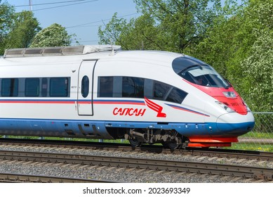 """LENINGRAD REGION, RUSSIA - MAY 24, 2021: The head car of the high-speed electric train EVS-2 """"Sapsan"""" on a sunny May day. Russian Railways"""