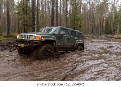 Leningrad region. Russia, November 16, 2018: big SUVs Hummer H3 overcoming a water barrier. Leningrad region . H3 is a compact four wheel drive off road and sport utility vehicle