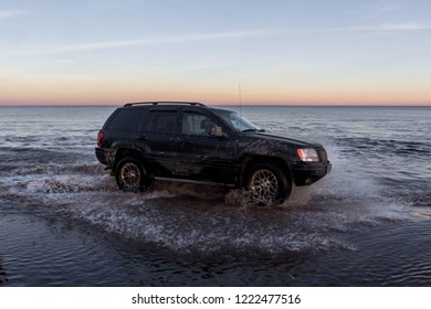 Leningrad region. Russia, November 4, 2018: Jeep Cherokee overcoming a water barrier. Leningrad region . Cherokee is a compact four wheel drive off road and sport utility vehicle