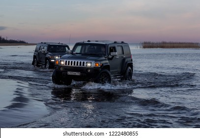 Leningrad region. Russia, November 4, 2018: Hummer H3 overcoming a water barrier. Leningrad region . H3 is a compact four wheel drive off road and sport utility vehicle