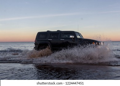 Leningrad region. Russia, November 4, 2018: big SUVs Hummer H3 overcoming a water barrier. Leningrad region . H3 is a compact four wheel drive off road and sport utility vehicle