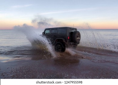 Leningrad region. Russia, November 4, 2018: Jeep Wrangler overcoming a water barrier. Leningrad region . Wrangler is a compact four wheel drive off road and sport utility vehicle