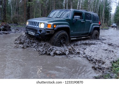 Leningrad region. Russia, November16, 2018: Hummer H3 overcoming a water barrier. Leningrad region . H3 is a compact four wheel drive off road and sport utility vehicle