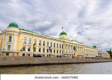 Leningrad Regional Court building on promenade of Fontanka river, blue dramatic sky background, Saint Petersburg Leningrad city, Russia