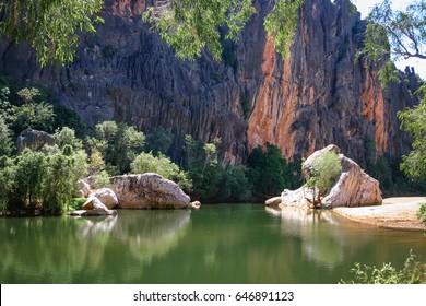 The Lennard River carves a stunning canyon through the Napier Range at Windjana Gorge, Kimberley, Australia, the permanent pools providing a permanent habitat for dozens of freshwater crocodiles.