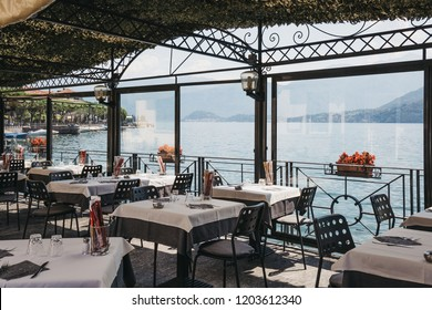 Lenno, Italy - July 5, 2017: View of Lake Como from a seaside Plinio restaurant in Lenno. Lake Como is the third-largest in Italy after lakes Garda and Maggiore and is a popular tourist destination.