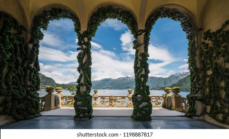 Lenno, Lake Como view with ivy Loggia columns from the balcony of Villa del Balbianello, Italy
